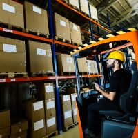 warehouse-worker-doing-logistics-work-with-forklif-GPV9KCY.jpg